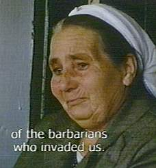 "Voice-over of a Greek-Cypriot complaining of the Turkish ""barbarians,"" while her pictured friend weeps"