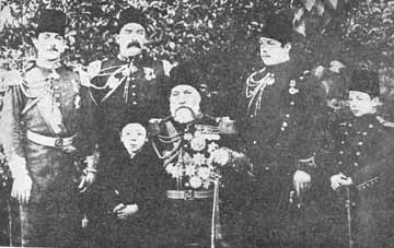 An aged Osman Pasha, with his sons
