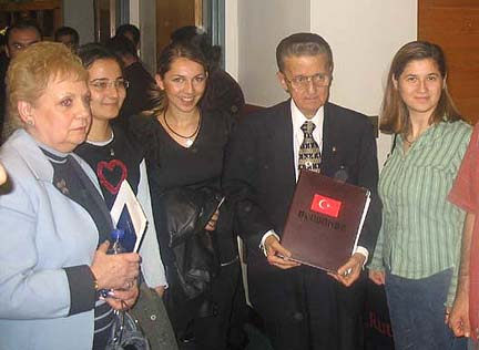 Edward Tashji as an invited speaker for the Turkish-American student organization at Rutgers University in 2004. His wife, Mary, is at left.